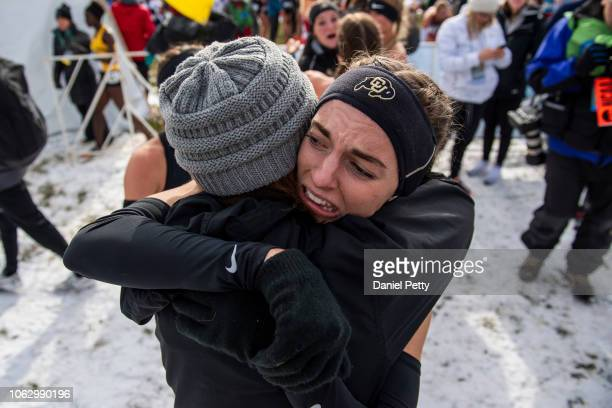 Colorado senior Dani Jones receives a hug from her mother after winning the NCAA cross country championship individual title at Thomas Zimmer...