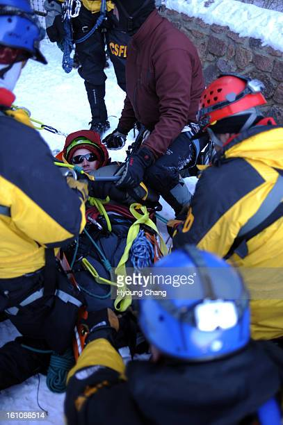 ICETRAINING Colorado Springs firefighters succeeded rescuing Jon Messersmith center during the training of ice climbing rescues at Silver Cascade...