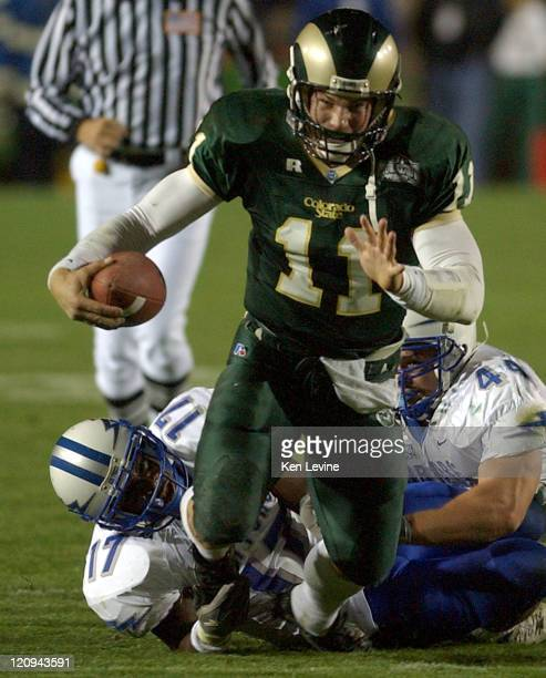 Colorado state quarterback Bradlee Van Pelt is atckled by two Air Force defenders Adrian Wright and Trevor Hightower during the third quarter at...