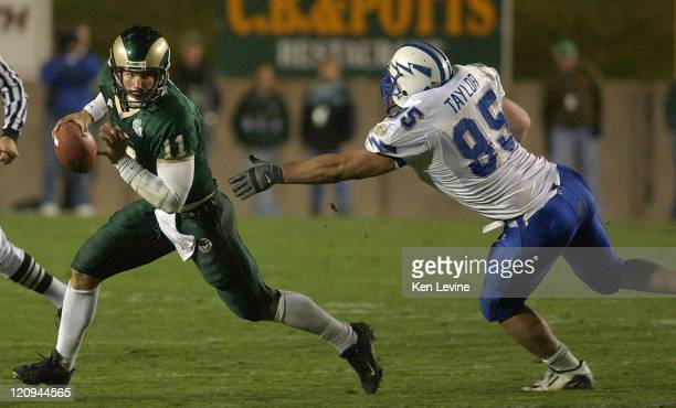 Colorado state quarterback Bradlee VCan Pelt eludes the tackle of Air Forces' Nicholas taylor during the third quarter at Sonny Lubick Field in Ft...