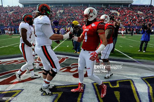 Colorado State Rams offensive lineman Ty Sambrailo left Utah Utes defensive back Brian Blechen greet each other after the coin toss for the Royal...