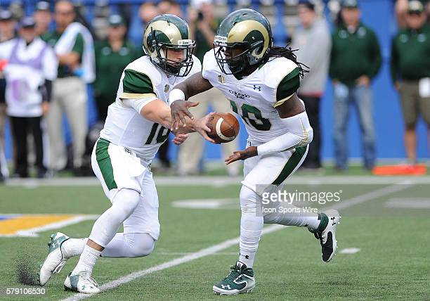 Colorado State Rams quarterback Garrett Grayson hands off to Rams running back Dee Hart during a NCAA football game between the Colorado State Rams...