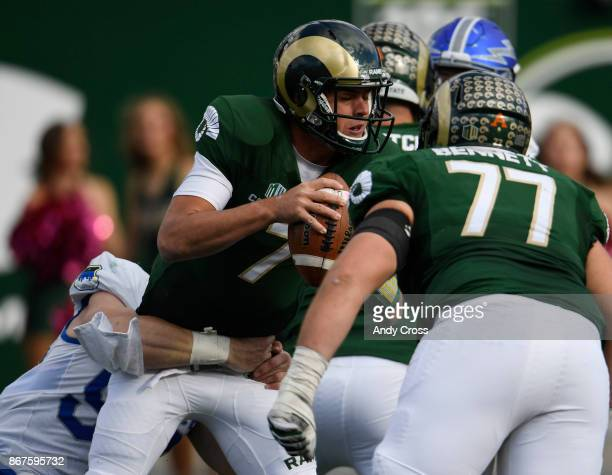 Colorado State Rams quarterback Nick Stevens gets sacked by Air Force Falcons linebacker Jack Flor in the third quarter at the Colorado State...