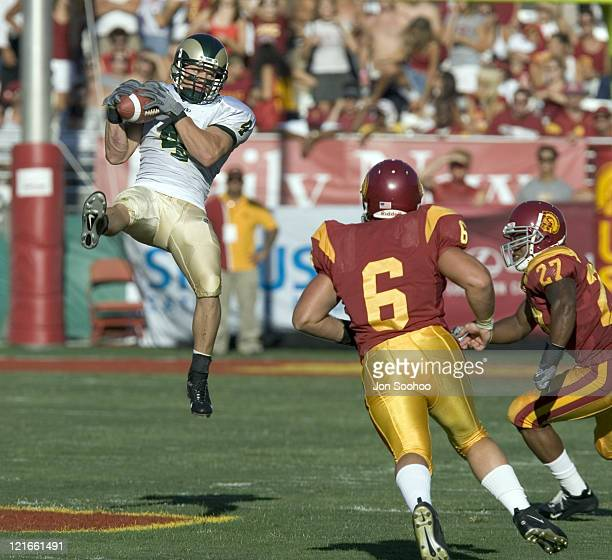 Colorado State Rams receiver David Andersonleft catches a pass vs USC Trojans secondary in the first quarter Saturday September 11 2004 at the Los...
