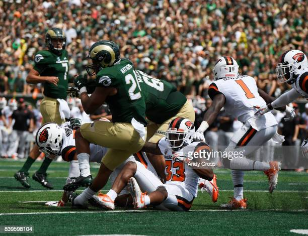 Colorado State Rams running back Izzy Matthews scores the first touchdown at the Colorado State University Stadium against Oregon State in the first...