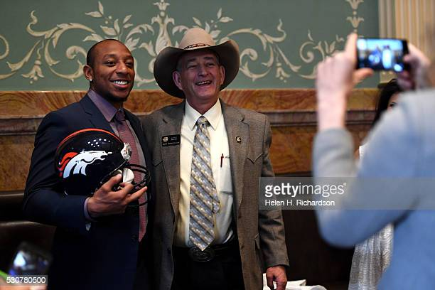 Colorado State Representative J Paul Brown right gets his photo taken with Denver Broncos cornerback Chris Harris right in the House Chambers on the...