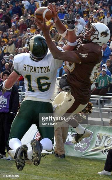 Colorado states Ben Stratton gets his arm in the way of a pass into the endzone intended for Wyoming's Malcom Floyd 88 Stratton wound up taking the...