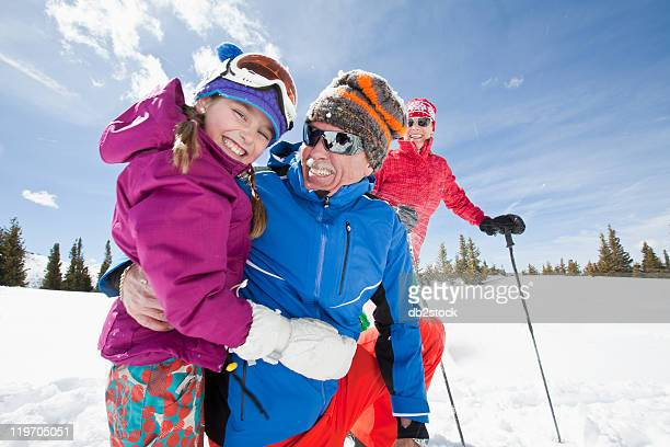 usa, colorado, telluride, grandparents with girl (10-11) posing during ski holiday - ski holiday stock photos and pictures