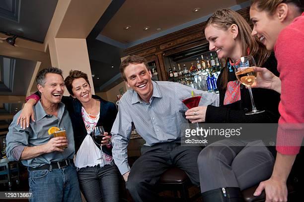 USA, Colorado, Telluride, Group of people enjoying apres ski drink in bar