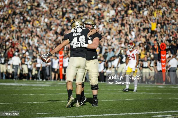 Colorado tight end Chris Bounds celebrates with teammate Gerrad Kough after scoring a touchdown that would be called back against USC during the...