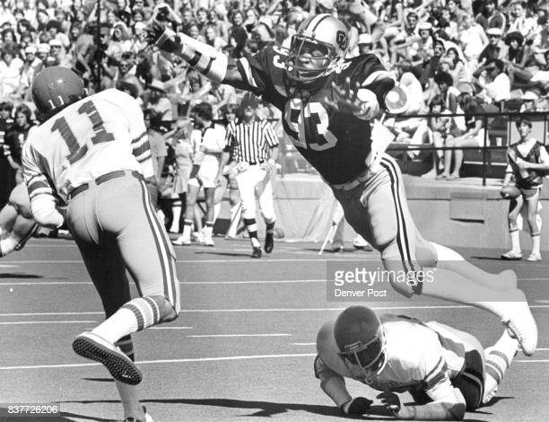Colorado University Athletics Football City meanwhile at Boulder Ed Lumor of San Jose State gets off pass despite lunging effort by Colorado's Stu...
