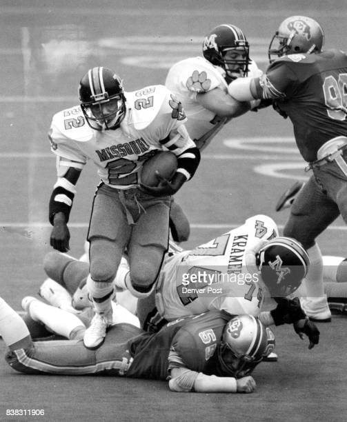 Colorado University Athletics Football Missouri's Santio Barbosa runs over a hapless Buff defender for a secondquarter touchdown Credit The Denver...