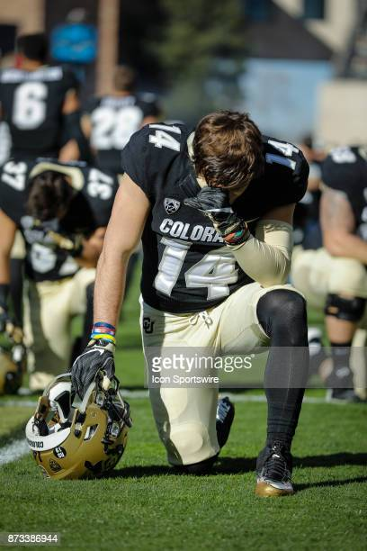 Colorado wide receiver Jay MacIntyre takes a knee before the Colorado Buffalos game versus the USC Trojans on November 11 at Folsom Field in Boulder...