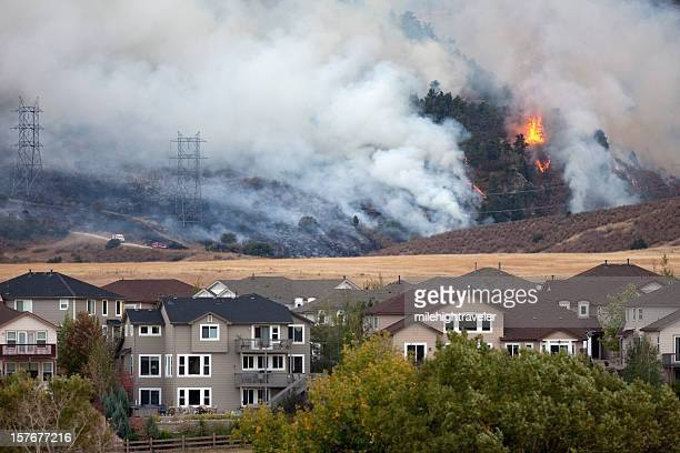 Colorado wild fire burns behind homes