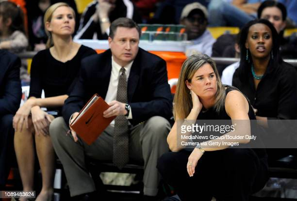 Colorado women's basketball head coach Kathy McConnellMiller watches her defense work as from back left director of basketball operations Ann...