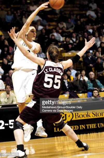 Colorados Amber Metoyer passes the ball over the head of Texas AMs Lynn Classen during Wednesday nights game at the Coors Events Center