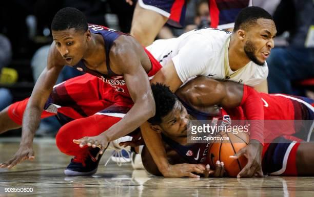 Colorado's Dallas Walton battles Arizona's DeAndre Ayton and Dylan Smith for a loose ball on the floor during their regular season PAC12 basketball...