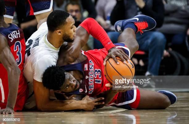 Colorado's Dallas Walton battles Arizona's DeAndre Ayton for a loose ball on the floor during their regular season PAC12 basketball game on January...