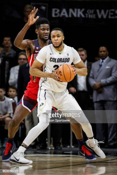 Colorado's Dallas Walton posts up in front of Arizona's DeAndre Ayton during their regular season PAC12 basketball game on January 06 2018 at the...