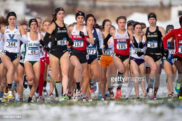 Colorado's Dani Jones and Tabor Scholl race during the NCAA cross country championships at Thomas Zimmer Championship Course on November 17 in Verona...