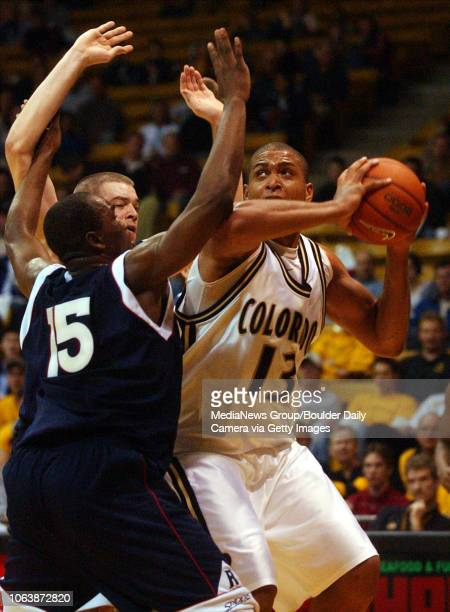 Colorado's David Harrison right tries to shoot over Gaston Moliva and Patrick O'Malley both of the University of Richmond on Dec 31 2003 in Boulder
