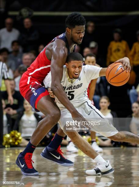 Colorado's Dominique Collier tries to dribble past Arizona's DeAndre Ayton during their regular season PAC12 basketball game on January 06 2018 at...