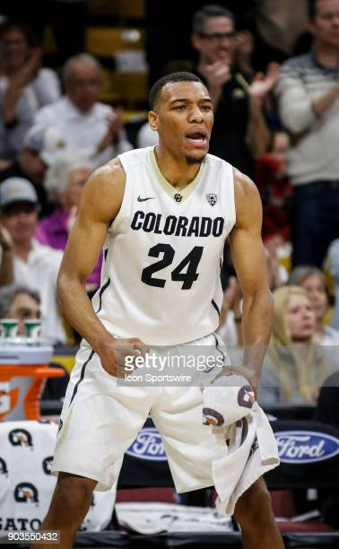 Colorado's George King celebrates celebrates off the bench on the way to upsetting a ranked Arizona team during their regular season PAC12 basketball...