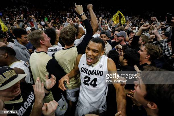 Colorado's George King celebrates with fans after upsetting off a ranked Arizona team during their regular season PAC12 basketball game on January 06...