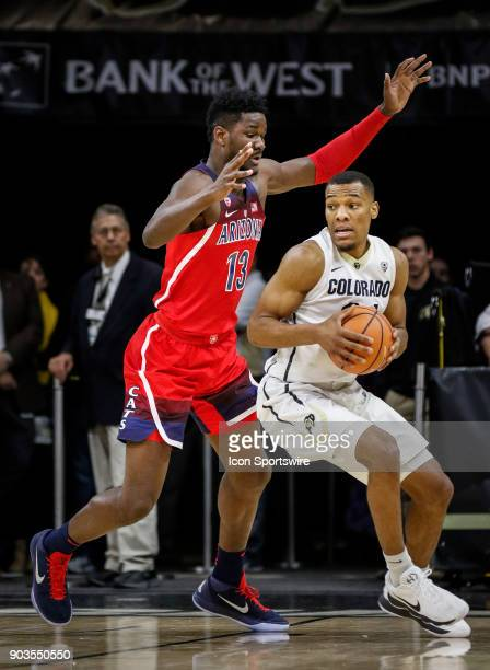 Colorado's George King looks to make a move in front of Arizona's DeAndre Ayton during their regular season PAC12 basketball game on January 06 2018...