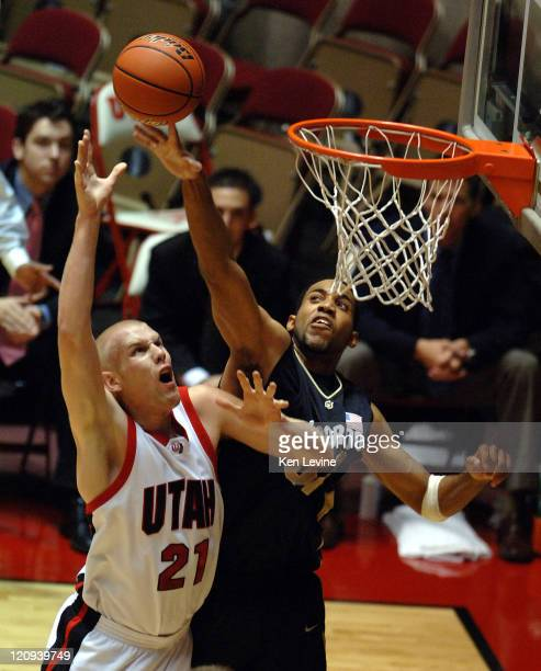 Colorados' Jermyl Jackson-Wilson blocks the shot of Utahs' Shaun Green at the Huntsman Center in Salt Lake City Tuesday Nov. 21, 2006.