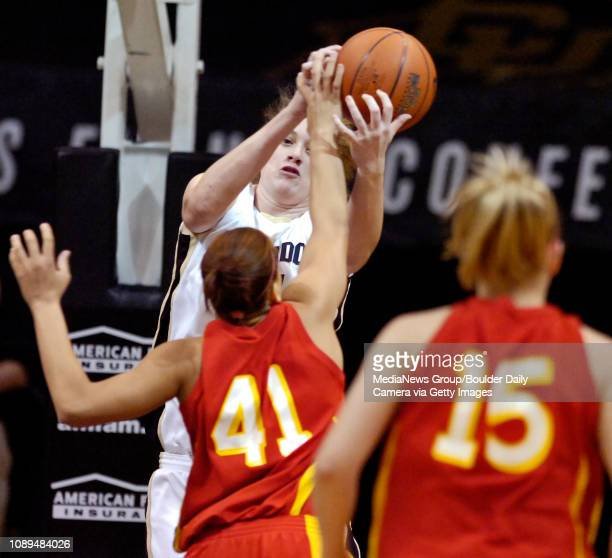 Colorado's Kara Richards grabs a defensive rebound from Iowa State's Toccara Ross as Heather Ezell looks on in the first half at Coors Events Center...