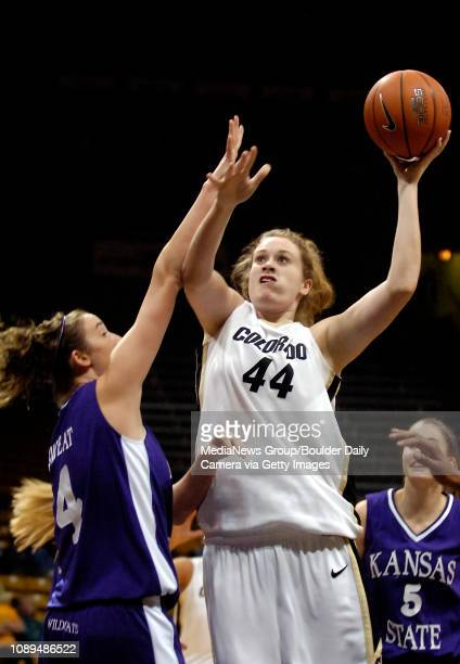 Colorado's Kara Richards posts up for a shot over Kansas State's Ashley Sweat in the first half at the Coors Event Center in Boulder Colo Wednesday...