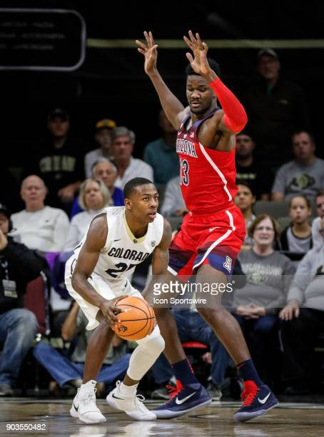 Colorado's McKinley Wright IV looks to pass in front of Arizona's DeAndre Ayton during their regular season PAC12 basketball game on January 06 2018...