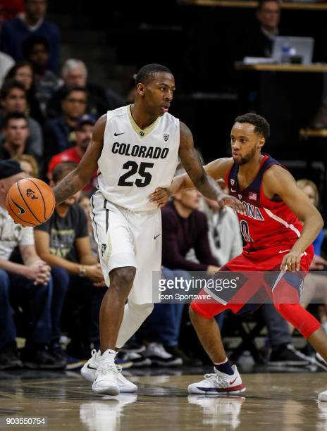 Colorado's McKinley Wright IV shields Arizona's Parker JacksonCartwright from the ball during their regular season PAC12 basketball game on January...