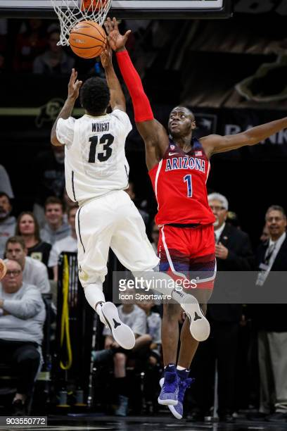 Colorado's Namon Wright tries to get a shot off in front of Arizona's Rawle Alkins during their regular season PAC12 basketball game on January 06...