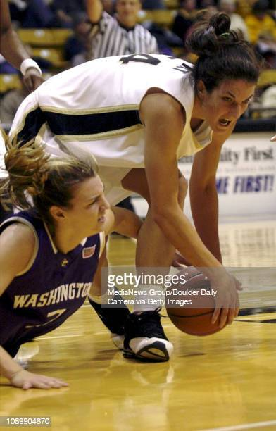 Colorados Randi Wirt and Washingtons Breanne Watson fight for a loose ball during Tuesday nights game in Coors Events Center in Boulder Co