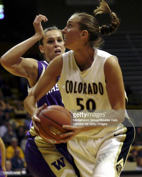 Colorados Tera Bjorkland looks up to shoot while being guarded by Washingtons Andrea Lalum during Tuesday nights game in Coors Events Center in...
