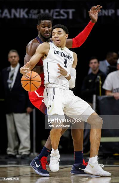 Colorado's Tyler Bey looks to put a spin move on Arizona's DeAndre Ayton during their regular season PAC12 basketball game on January 06 2018 at the...