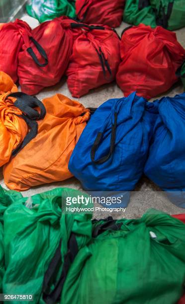 color-coded bags at the airport - highlywood fotografías e imágenes de stock