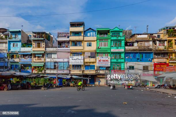 colored adjacent residences in ho chi minh city. - people's committee building ho chi minh city stock pictures, royalty-free photos & images