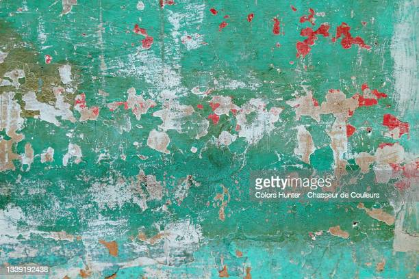 colored and patinated paints on a rough wall in havana - havana stock pictures, royalty-free photos & images