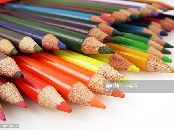 Colored art pencils close up against white