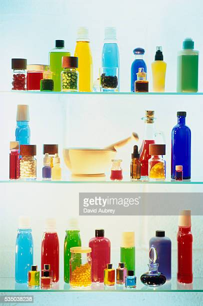 colored bottles in medicine cabinet - medicine cabinet stock pictures, royalty-free photos & images