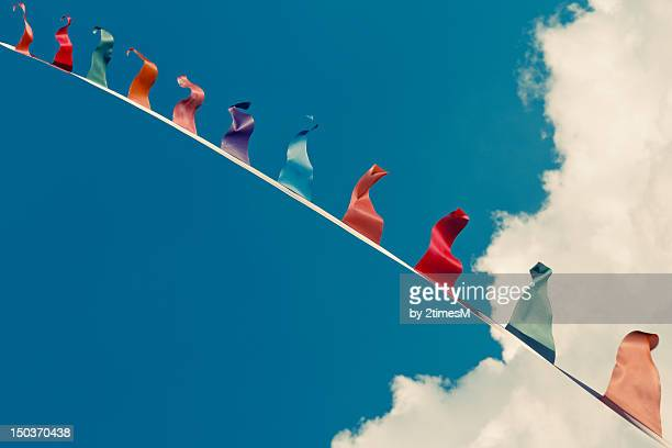 Colored bunting upside down on blue sky