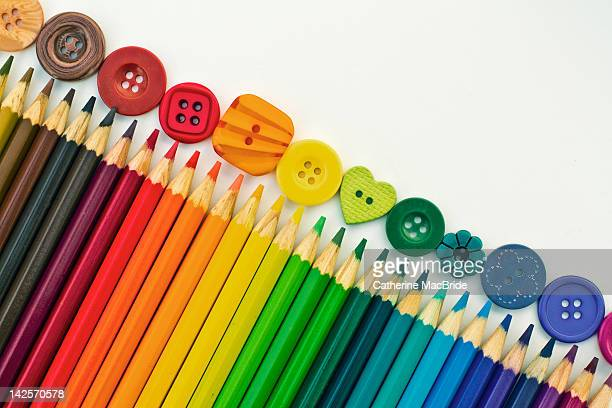 colored buttons and pencils - catherine macbride stock pictures, royalty-free photos & images