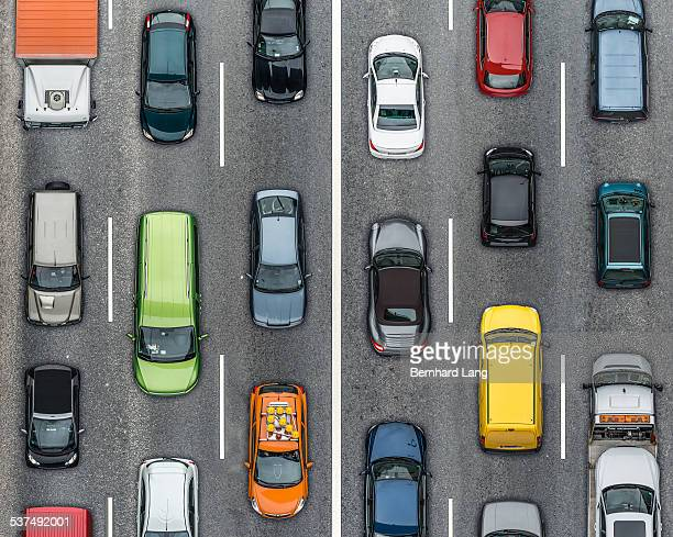colored cars on traffic lanes, aerial view - traffico foto e immagini stock