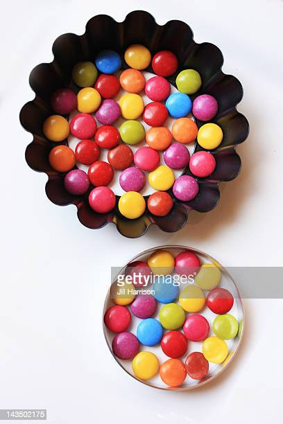 colored chocolate smarties lollies - jill harrison stock pictures, royalty-free photos & images