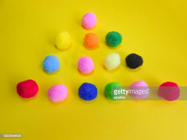 colored cotton balls - cotton wool stock pictures, royalty-free photos & images
