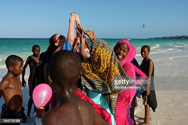 CONTENT] Colored dressed girls contesting a bracelet on Kiwenga beach in Zanzibar