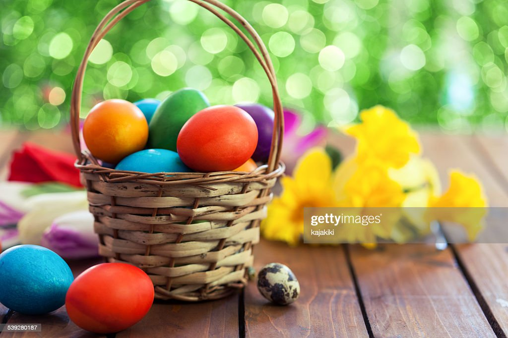 Colored Easter eggs in basket : Stock Photo